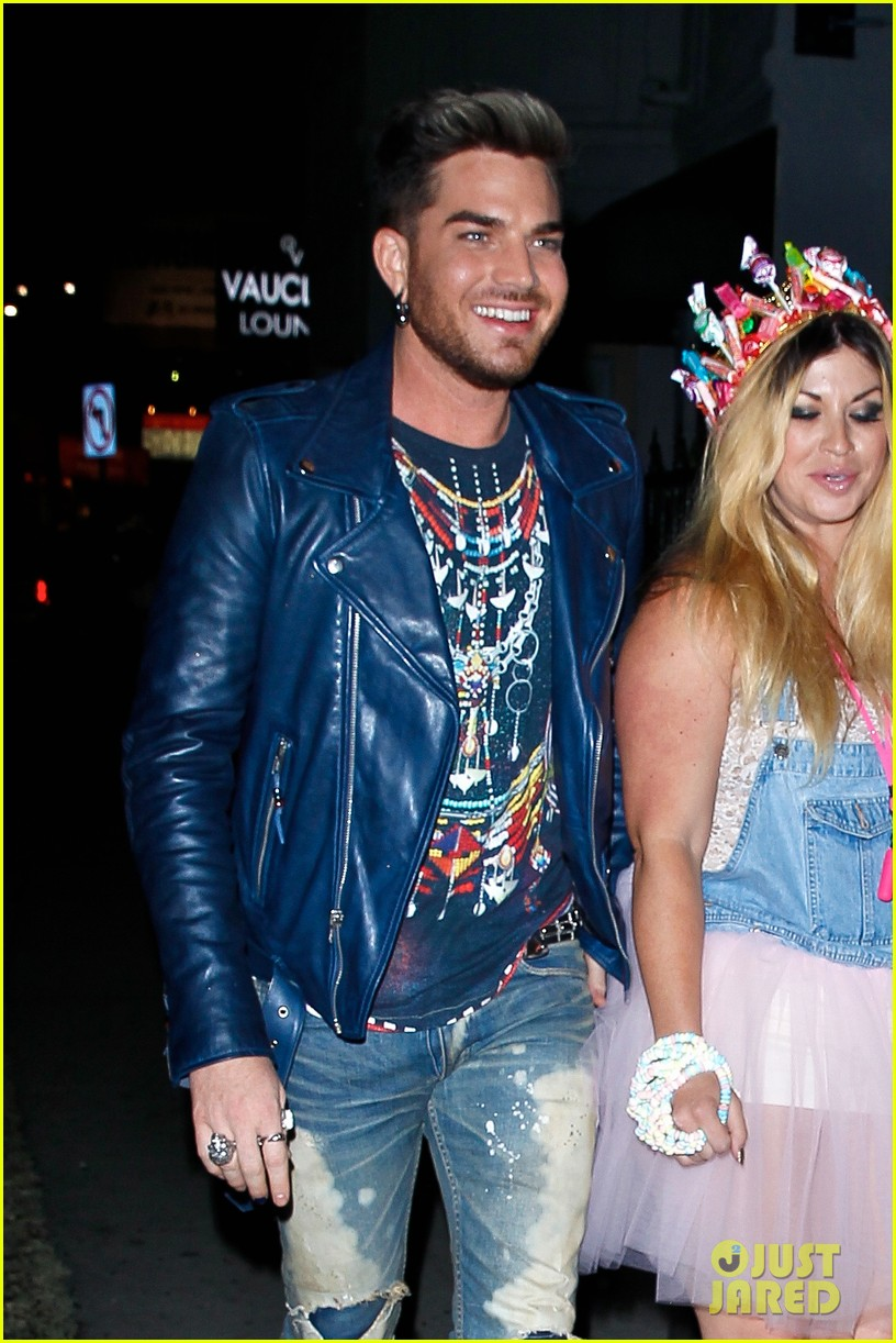 adam lambert looks like hes having a really fun night with friends 023111103