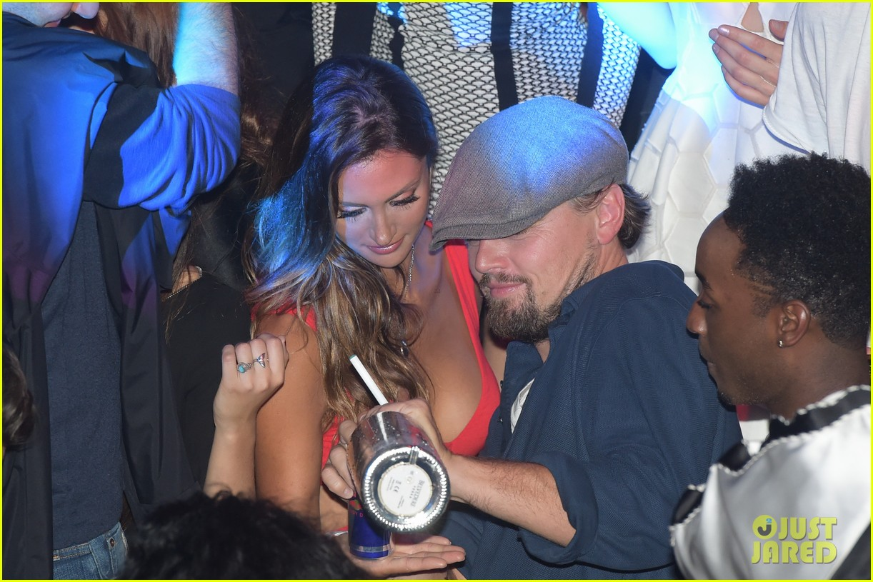 leonardo dicaprio surrounded by ladies at cannes 14