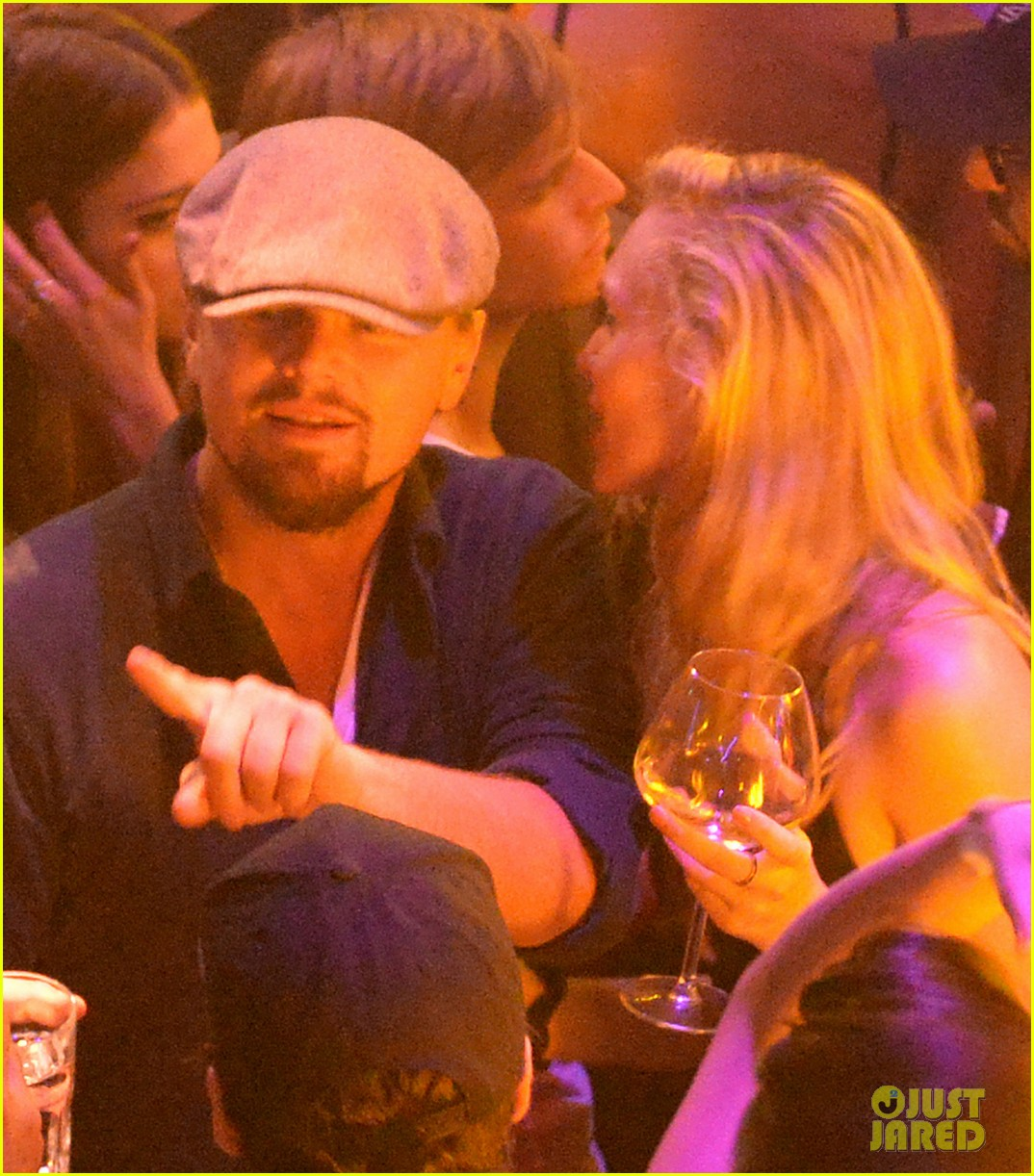 leonardo dicaprio surrounded by ladies at cannes 24