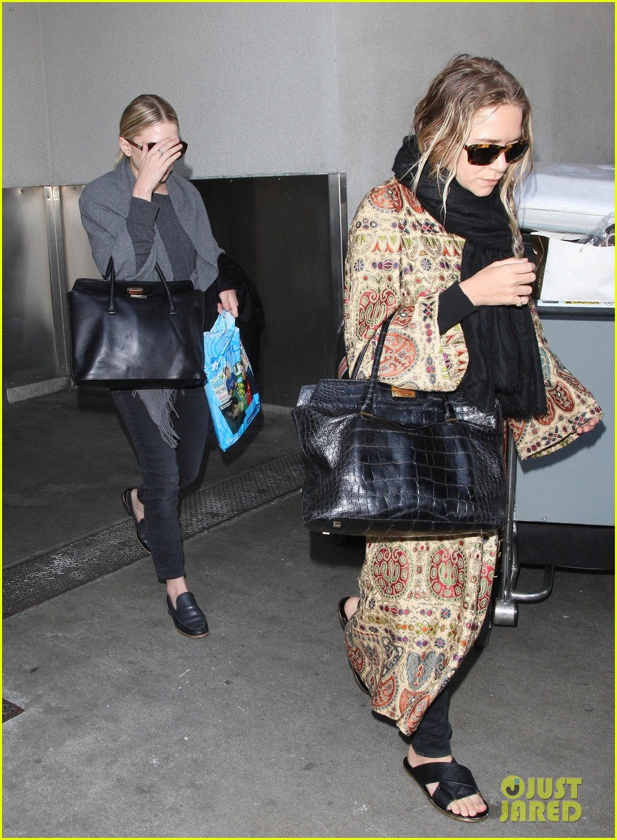 mary kate ashley olsen arrive in los angeles 033108200