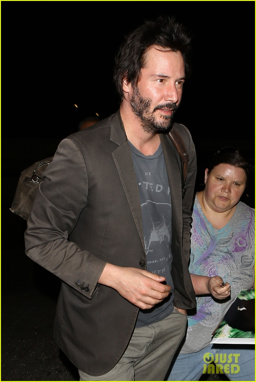 keanu reeves gets swarmed by fans at lax airport 08