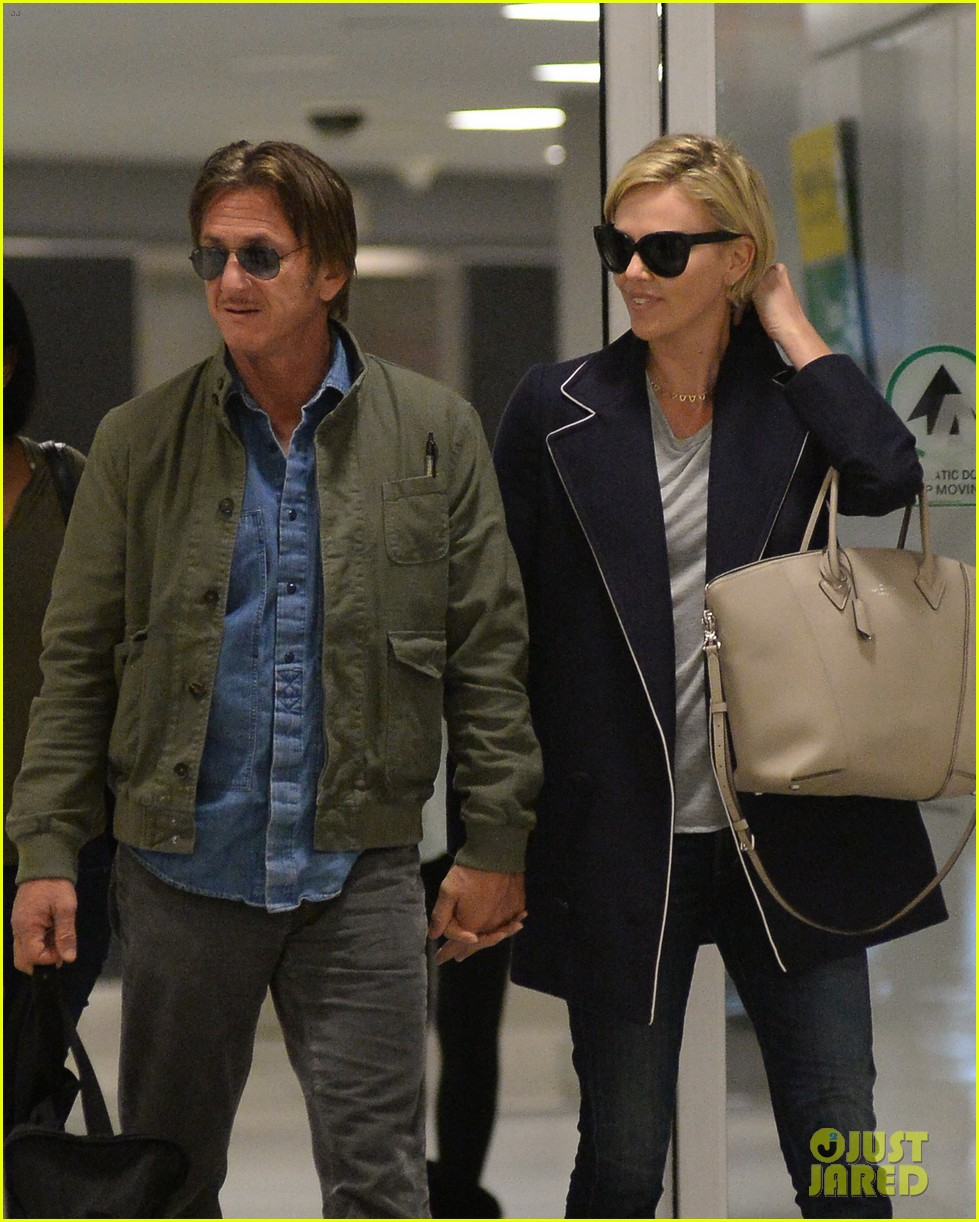 charlize theron sean penn hold hands upon new york arrival 08