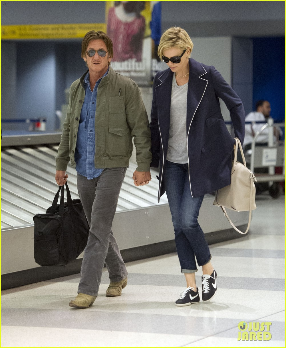 charlize theron sean penn hold hands upon new york arrival 293105583