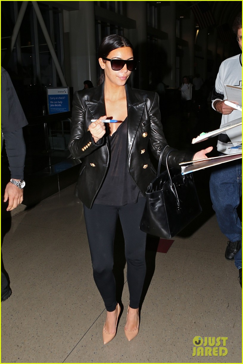 kim kardashian arrives at lax without new husband kanye west 01