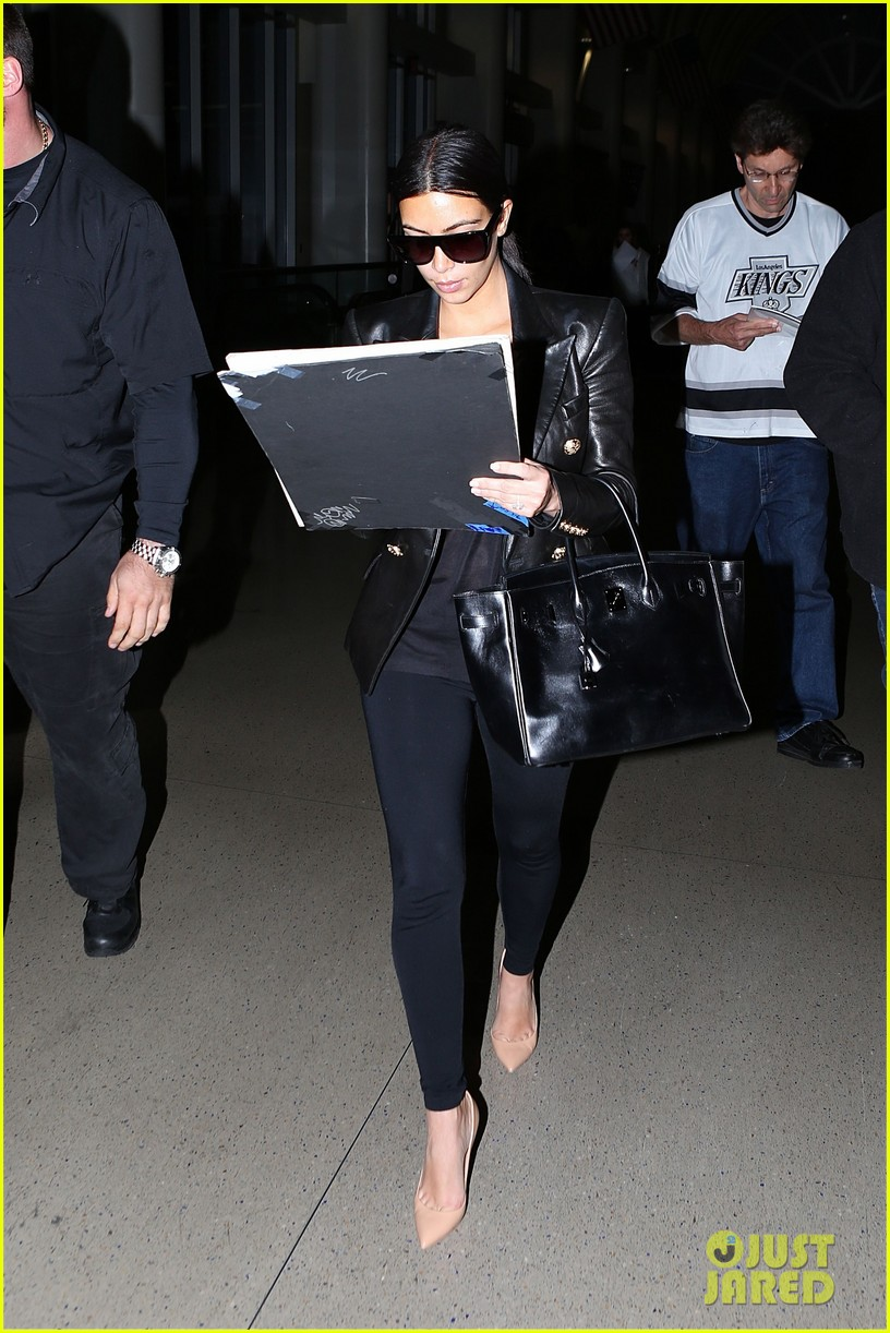 kim kardashian arrives at lax without new husband kanye west 043126204