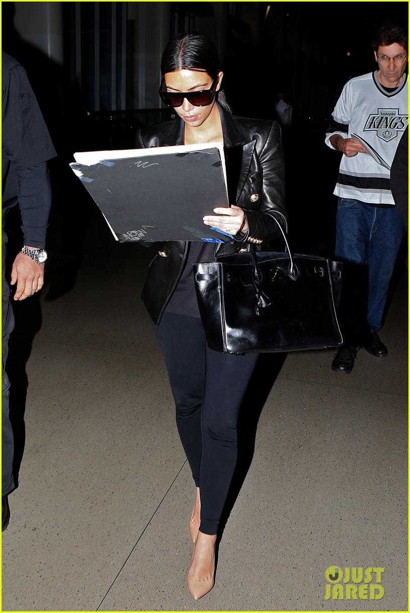 kim kardashian arrives at lax without new husband kanye west 113126211