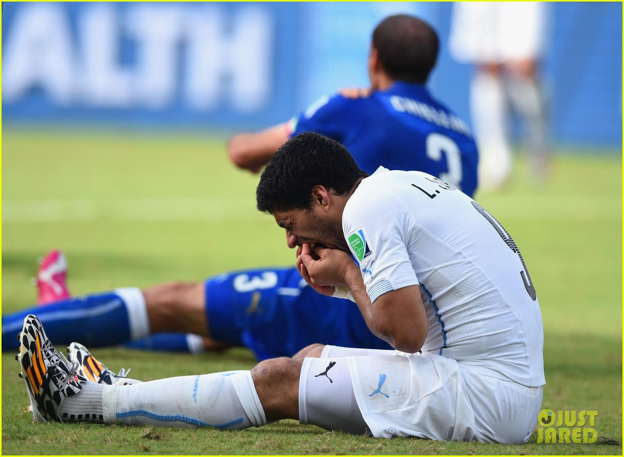 luis suarez banned from world cup for biting opponent 01
