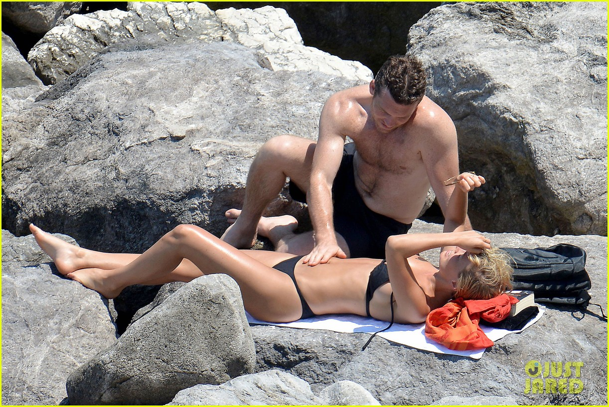 sam worthington lara bingle get handsy pack on the pda on beach 03