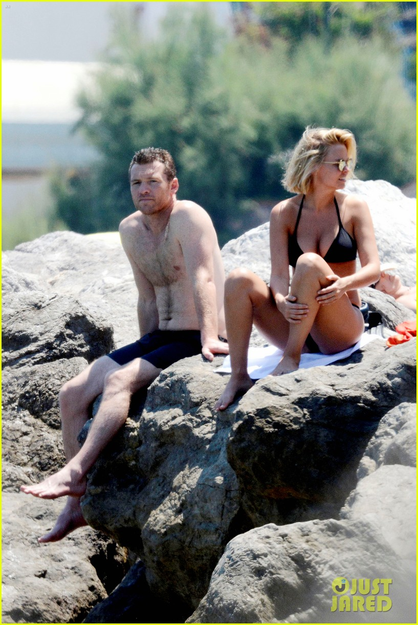 sam worthington lara bingle get handsy pack on the pda on beach 053134678
