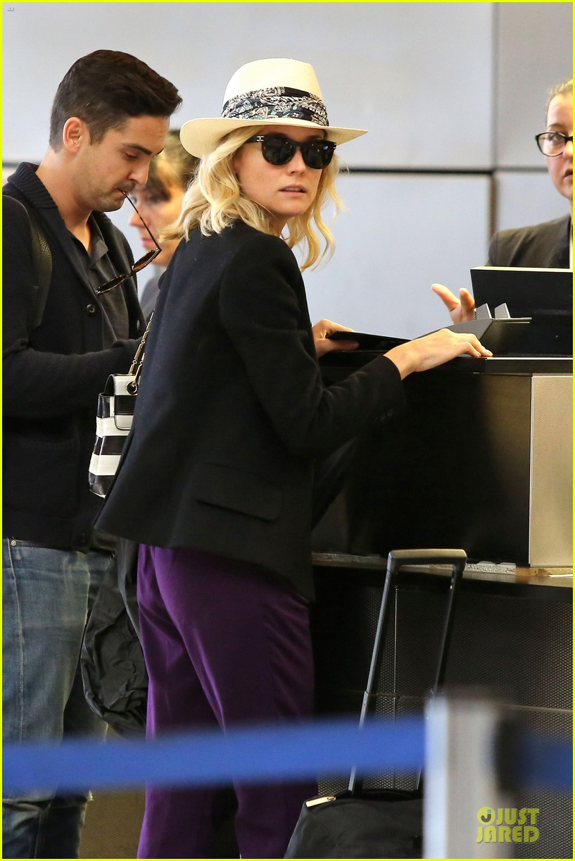 diane kruger wears purple pants at lax airport 063148009