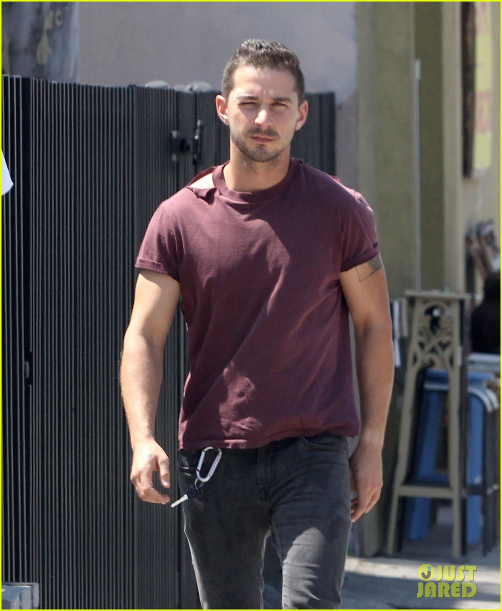 shia labeouf lifts his shirt bares torso 04