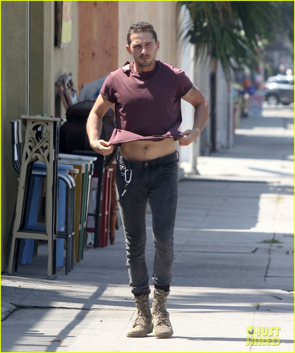 shia labeouf lifts his shirt bares torso 05