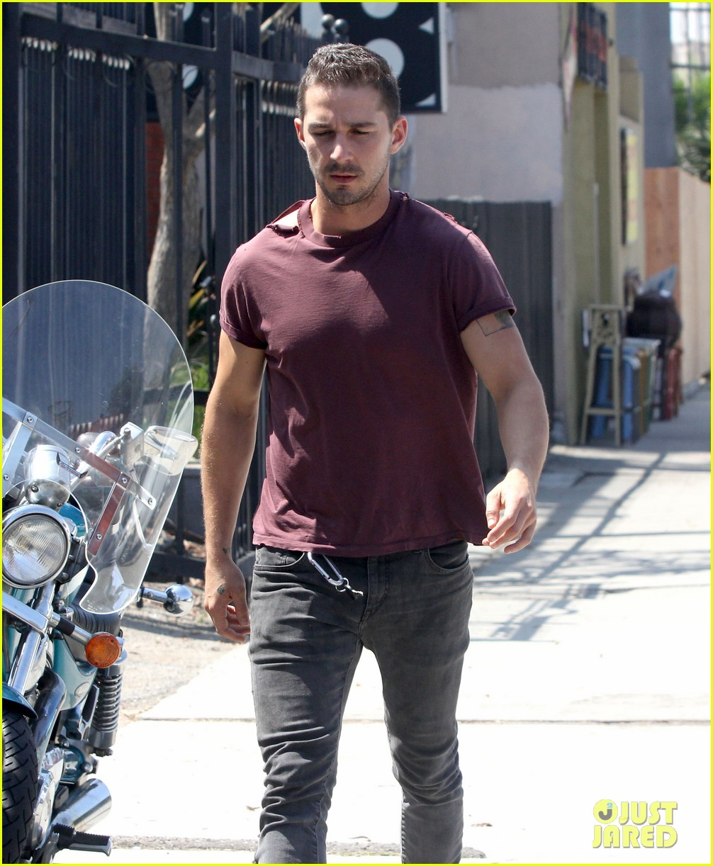 shia labeouf lifts his shirt bares torso 11