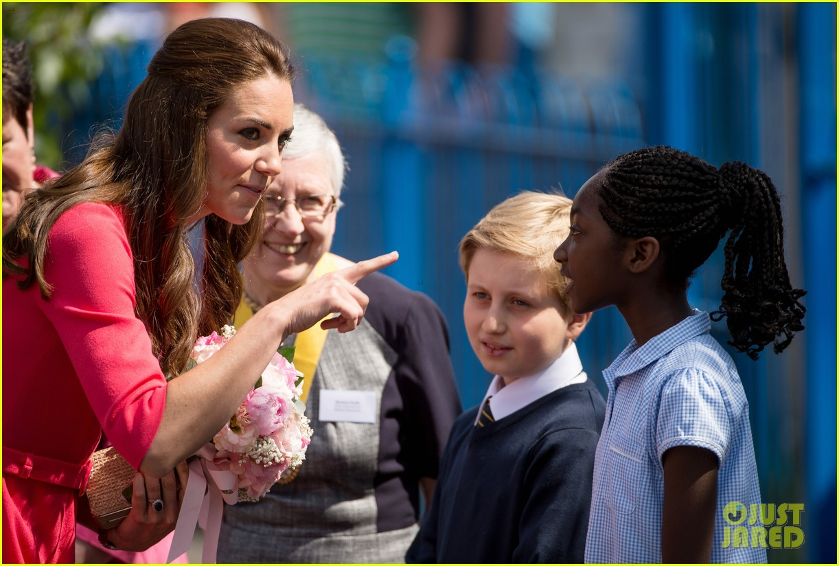 kate middleton is bright in pink for blessed sacrament school visit 07