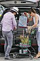 milla jovovich grocery trip friend 09