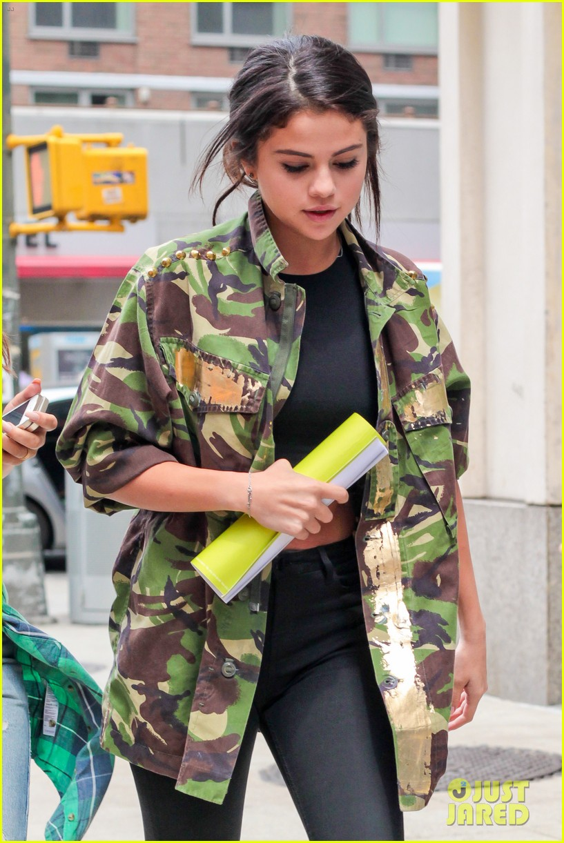 selena gomez covers up camo jacket 033153052