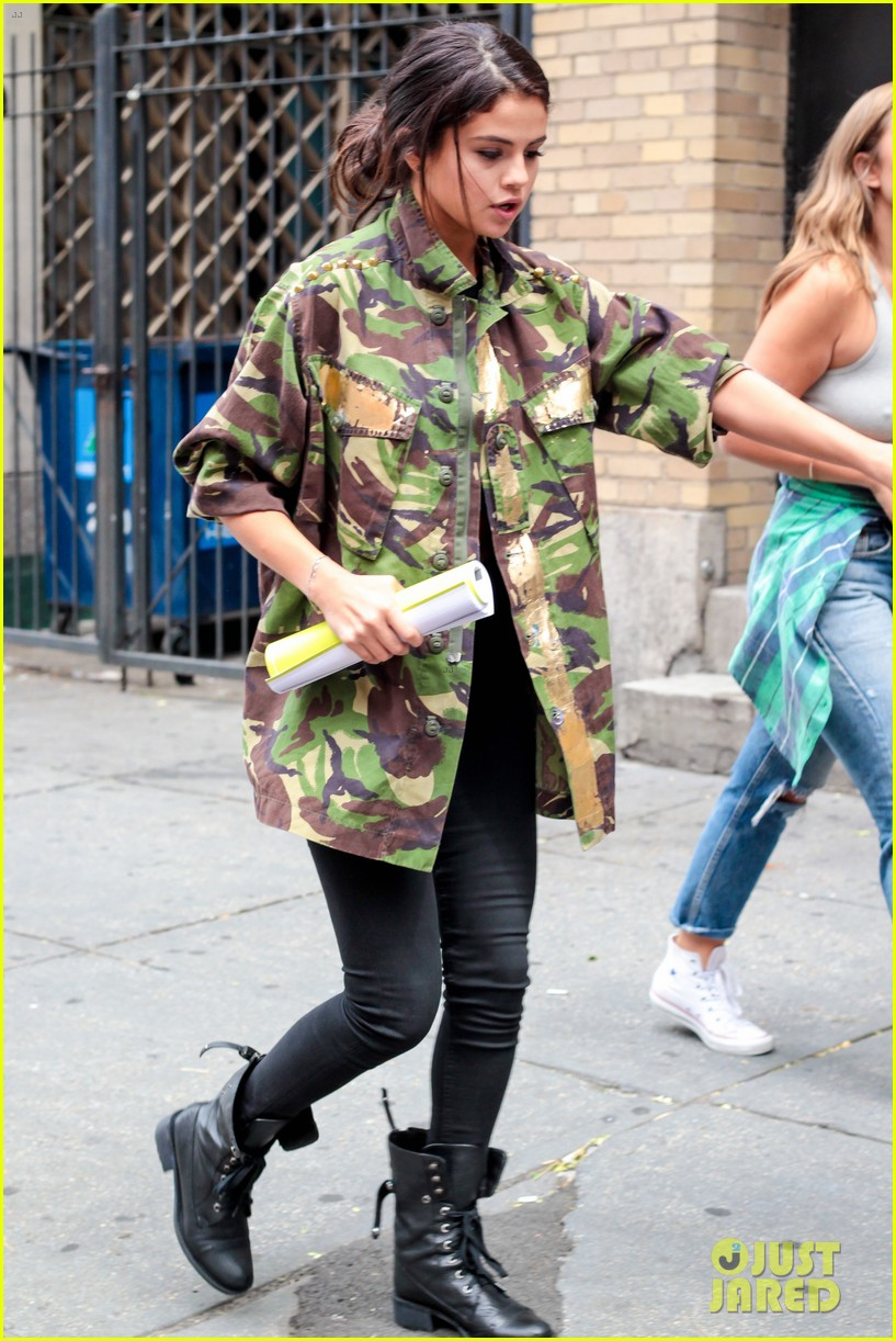 selena gomez covers up camo jacket 11