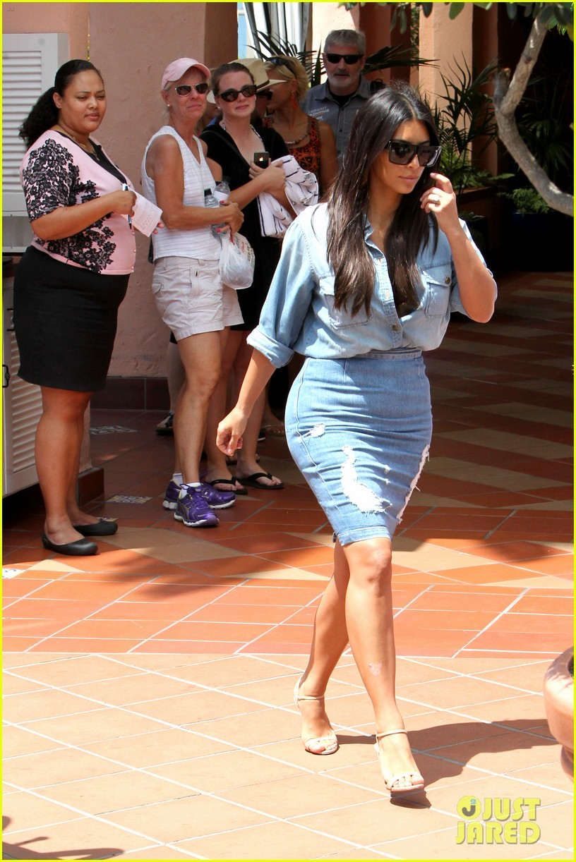 kim kardashian does double denim lots of cleavage on family outing 073181030