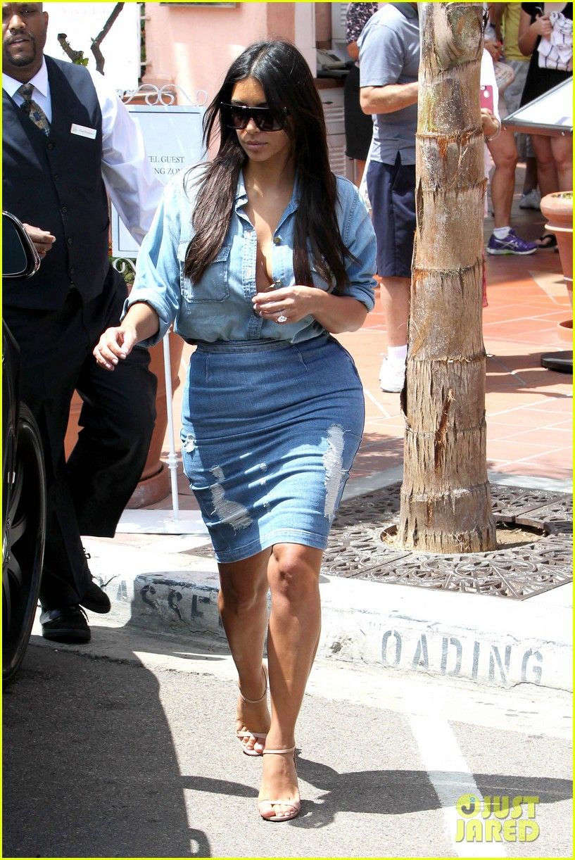 kim kardashian does double denim lots of cleavage on family outing 103181033