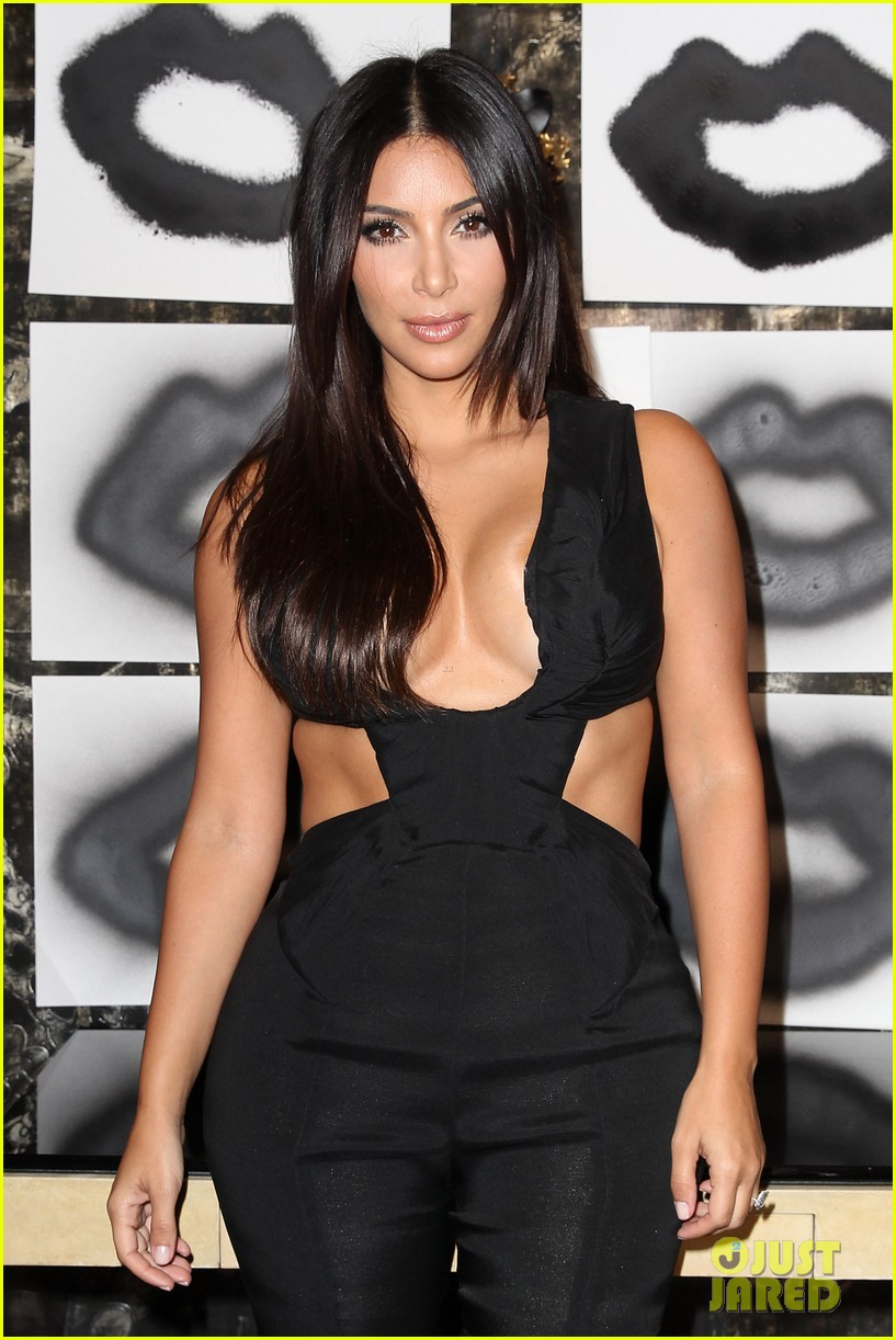 kim kardashian rocks super sexy revealing black jumpsuit 07
