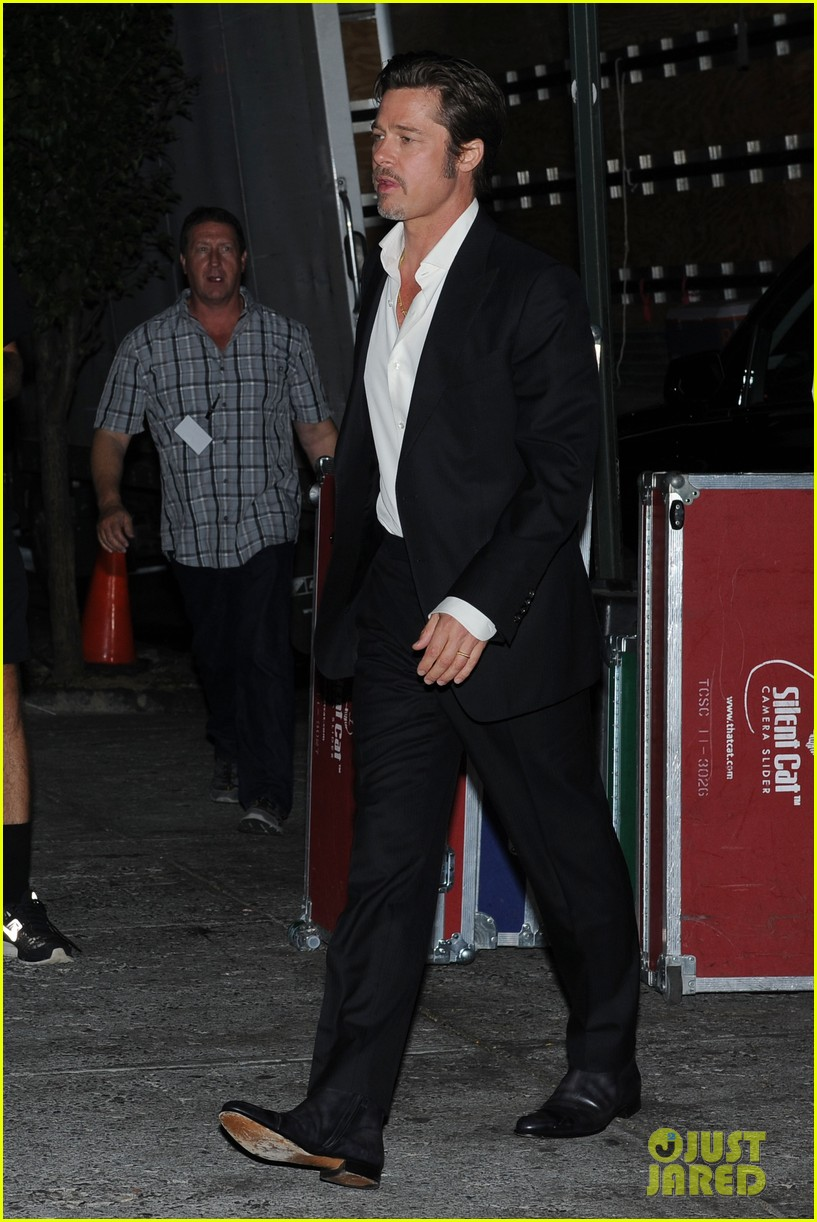 brad pitt suits up shows off wedding ring 01