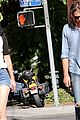 krysten ritter adam granduciel keep distance on stroll 08