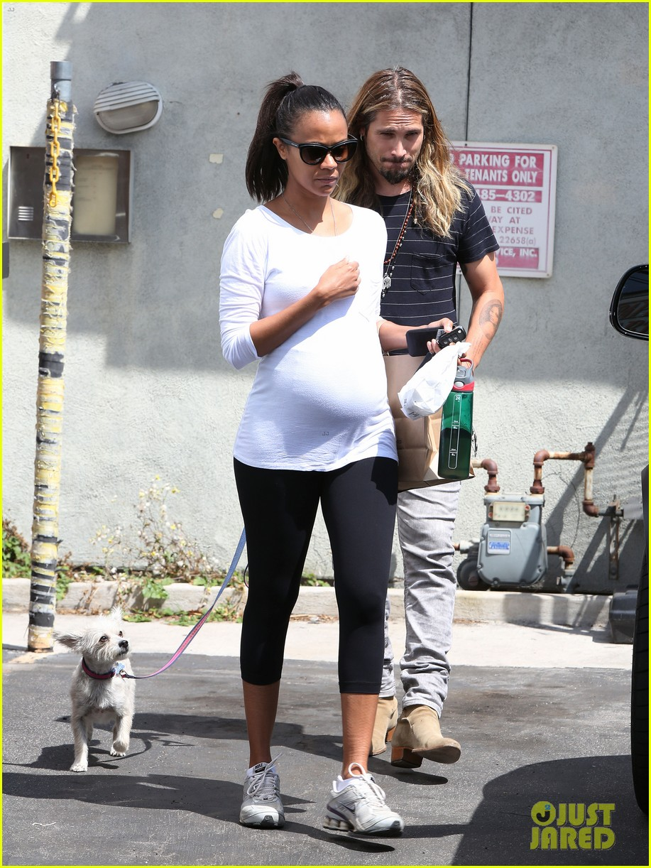 zoe saldana preps for baby at moms the word 04