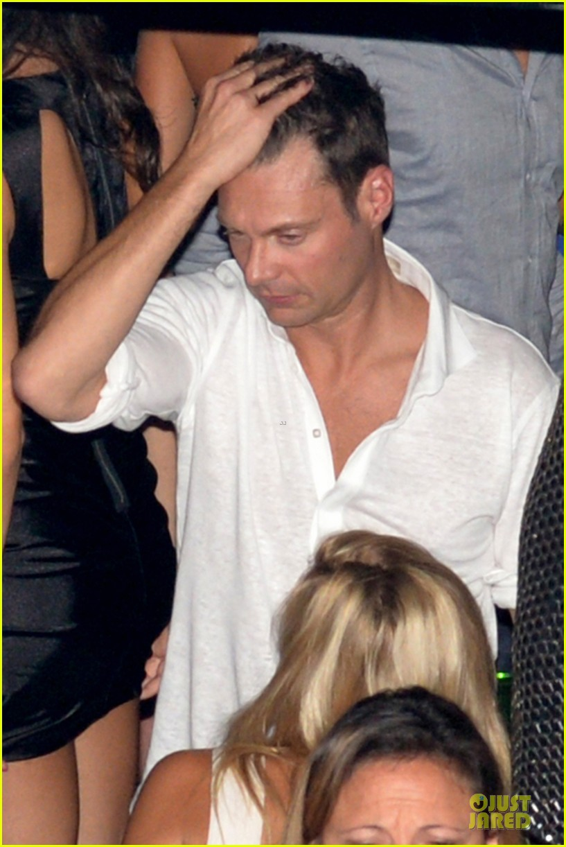 ryan seacrest pours small bucket over head 253181148