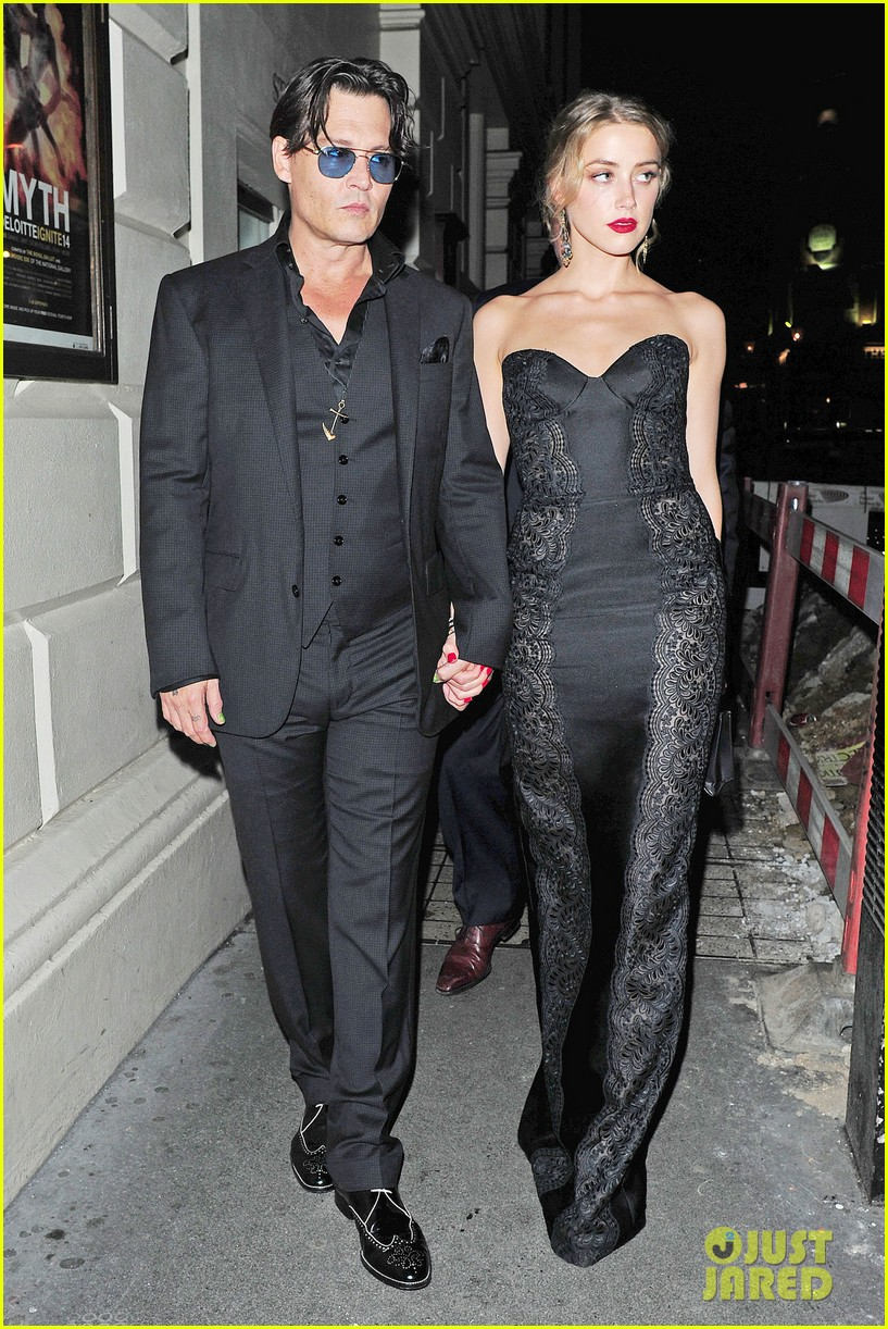 johnny depp amber heard hold hands gq men of the year awards 053189113