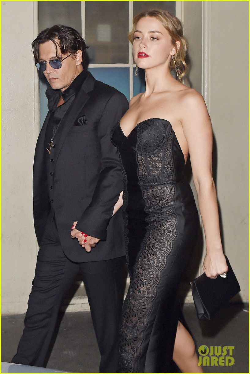 johnny depp amber heard hold hands gq men of the year awards 06