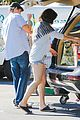 milla jovovich keeps her baby bump covered with baggy shirt 09