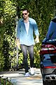 harry styles steps out before taylor swift out of woods drops 07