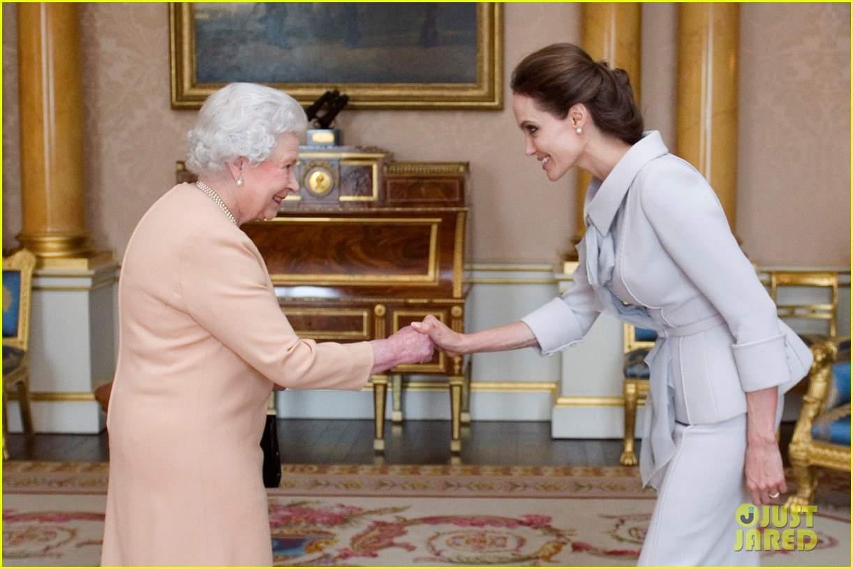 http://cdn04.cdn.justjared.com/wp-content/uploads/2014/10/jolie-queen/angelina-jolie-honorary-dame-queen-elizabeth-england-07.jpg