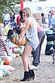 leann rimes lifts a huge pumpkin 01