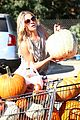 leann rimes lifts a huge pumpkin 05
