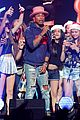 pharrell williams surrounded by girls jingle ball 06