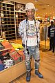 pharrell williams helps uniqlo host charity shopping event 09