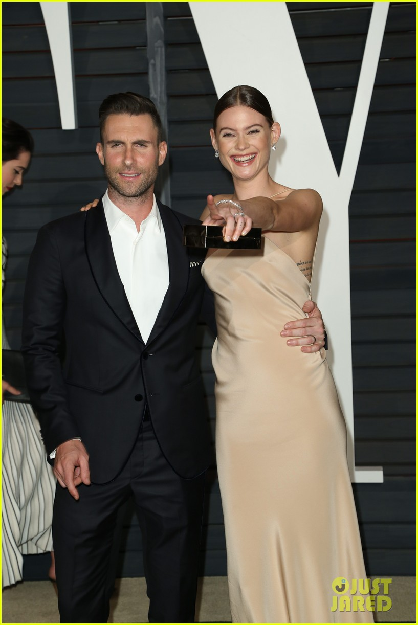 Adam Levine Hides Behati Prinsloos Nip Slip At Oscars Party Photo