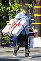benji madden carries huge presents 02