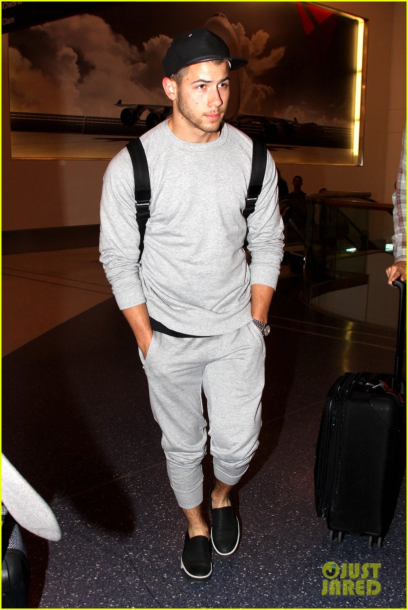 Full Sized Photo of nick jonas sweatpants for flight out ...
