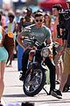 zac efron films baywatch on motorcycle 31