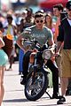 zac efron films baywatch on motorcycle 32