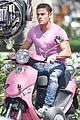 zac efron the rock film baywatch on a scooter 19