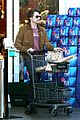 olivier martinez buys his baguette during his grocery run 11