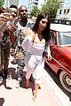 kim kardashian flaunts curves cleavage in white jumpsuit 03