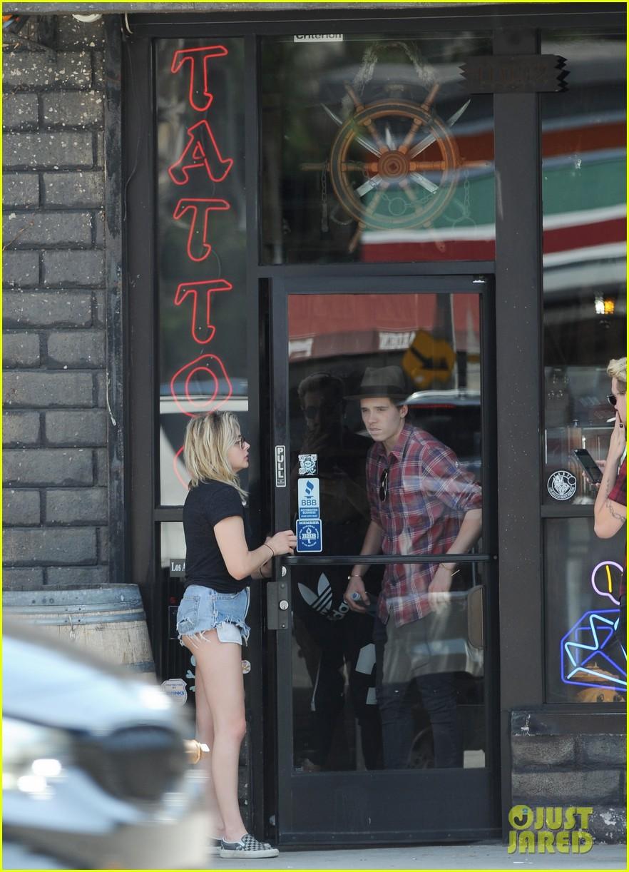 Chloe moretz brooklyn beckham stop by a tattoo shop for Tattoo shop brooklyn
