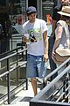 louis tomlinson goes barefoot at starbucks danielle campbell celebrated dcoms 15