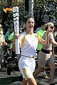 alessandra ambrosio and adriana lima carry the olympic torch 04