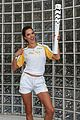 alessandra ambrosio and adriana lima carry the olympic torch 16
