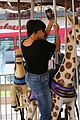 kourtney khloe kardashian ride a merry go round together 02